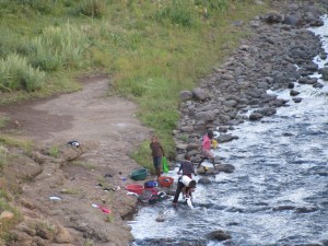Locals washing clothes in the river