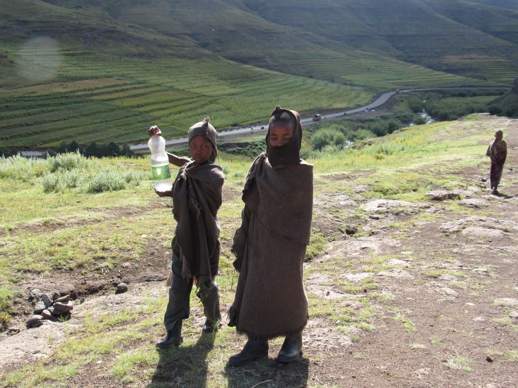 Young Basotho children with fresh spring water